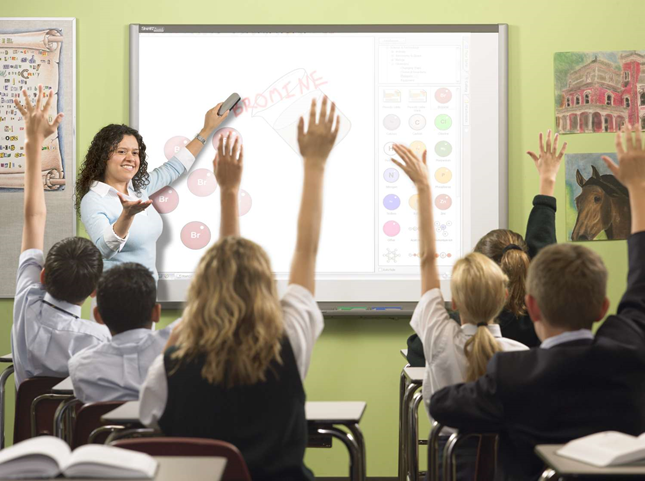 A teacher makes their students understand concepts using a smartboard